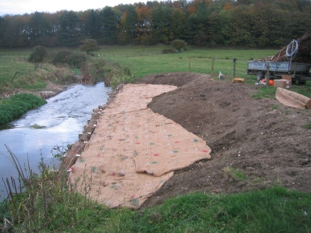 Recently created low berm (protected with hessian geotextile) alongside an itroduced gravel riffle